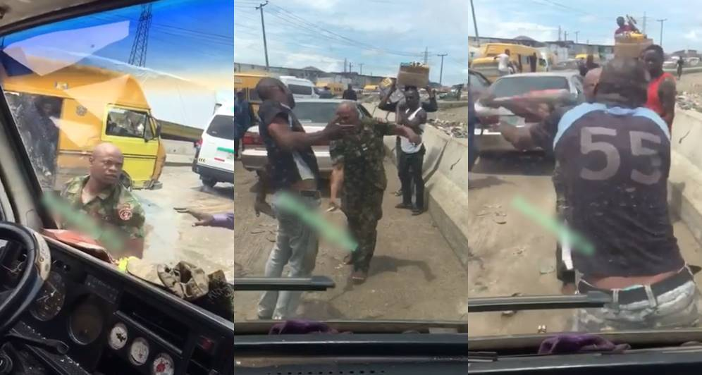 Soldier flogs driver, shatters his glass for overtaking him in Lagos (Video)